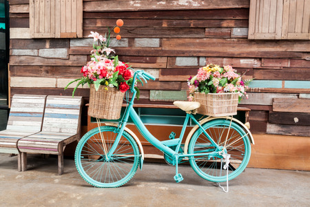 36064635 - vintage bicycle on vintage wooden house wall