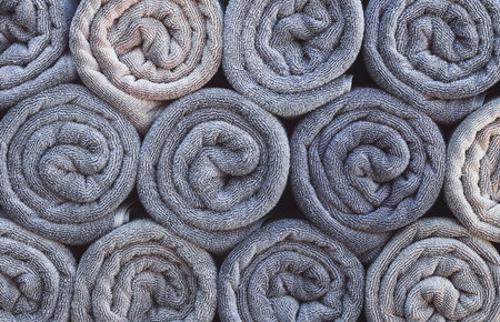 62343063 - stack of rolled towels in hotel near beach