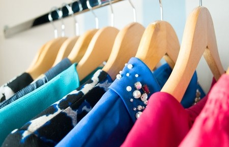 41066854 - different clothes on hangers close up