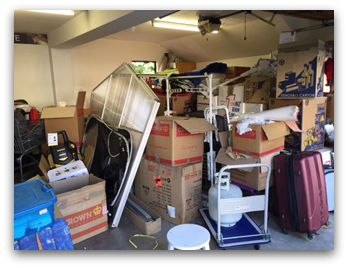 The garage before shot - lots of boxes to unpack before we can have a garage sale!